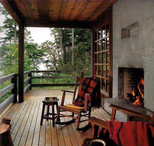 cabin porch with a rough concrete fireplace
