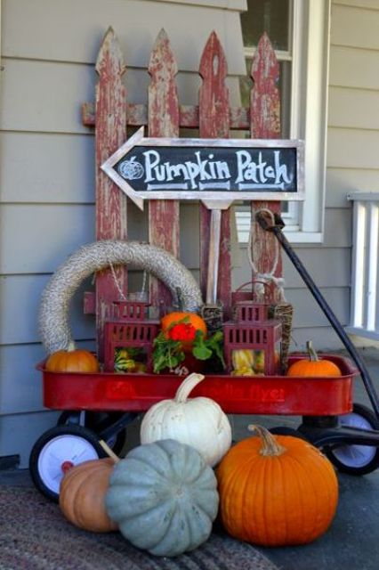 little red wagon to create a cute fall-ready display with tons of pumpkins, gourds, and antique finds