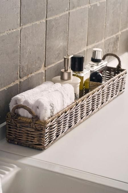 long wicker basket for storing bathroom supplies