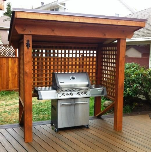 wooden pergola to cover a grill