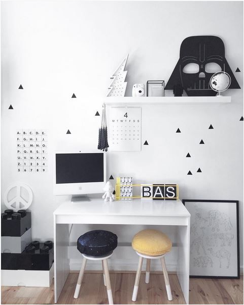 Scandinavian study space with a sleek desk and stools