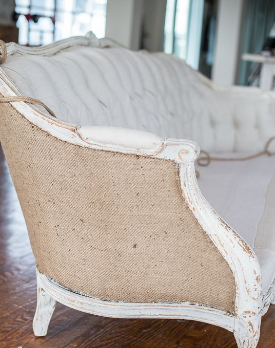back of an antique sofa upholstered with burlap