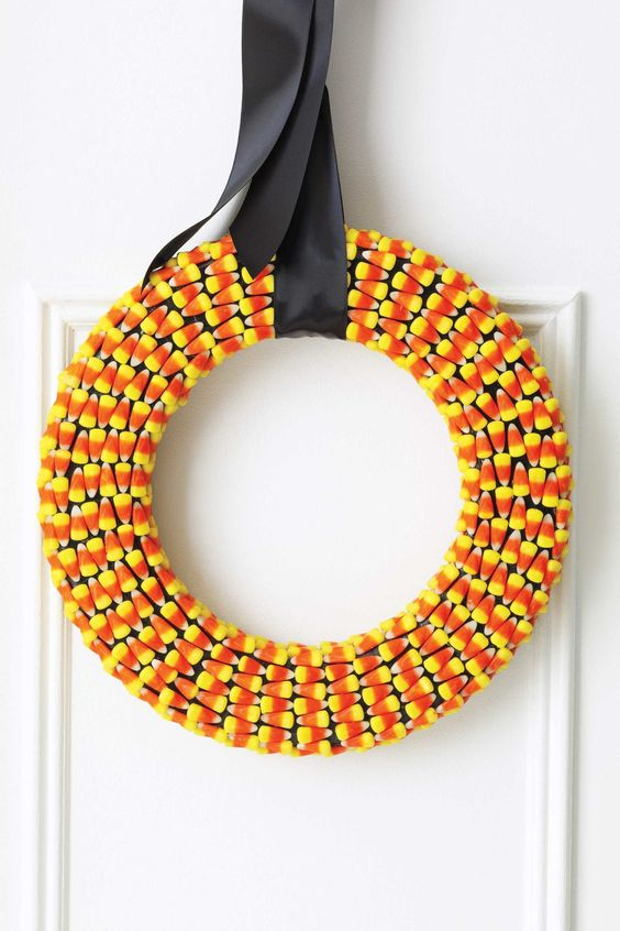 candy corn wreath with black ribbon