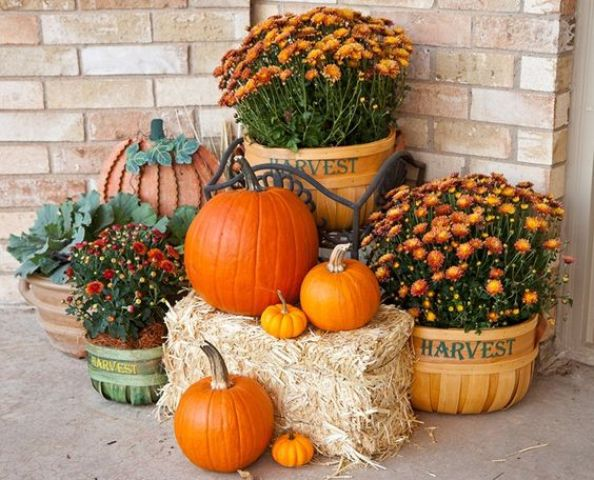 mums, pumpkins and some hay for a rustic porch