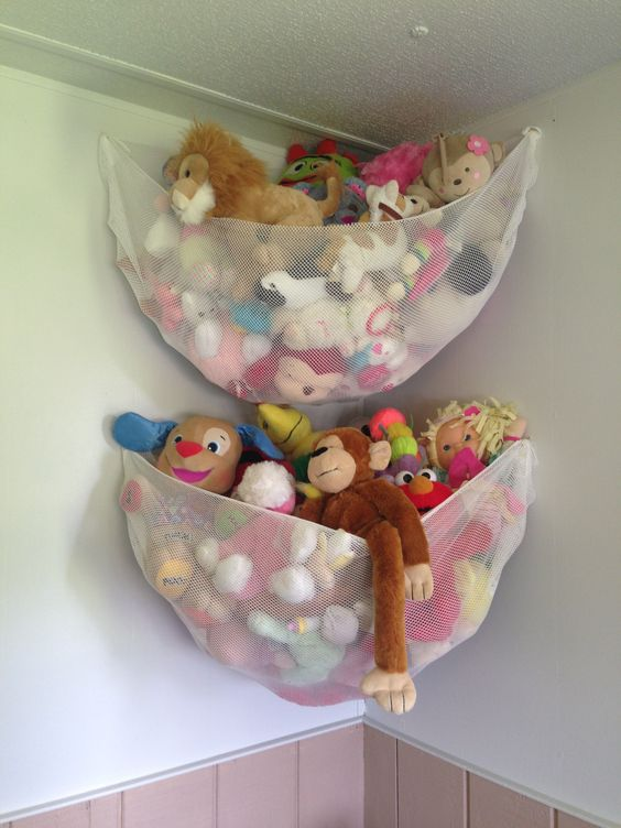 net fabric on hooks for hanging toy storage