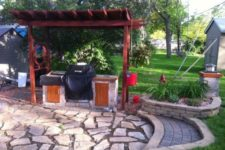 10 Wood pergola over grill and rock patio
