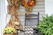 10 a fall porch decor with cornstalks, a DIY wreath and chevron pillows
