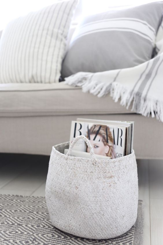 white woven basket for storing magazines