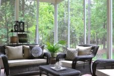11 relaxing screened space with dark wicker furniture