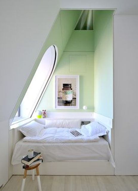 tiny reading nook in the niche by the attic window