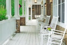 11 wrap around porch with rocking chairs and a swing to sit in and watch the kids