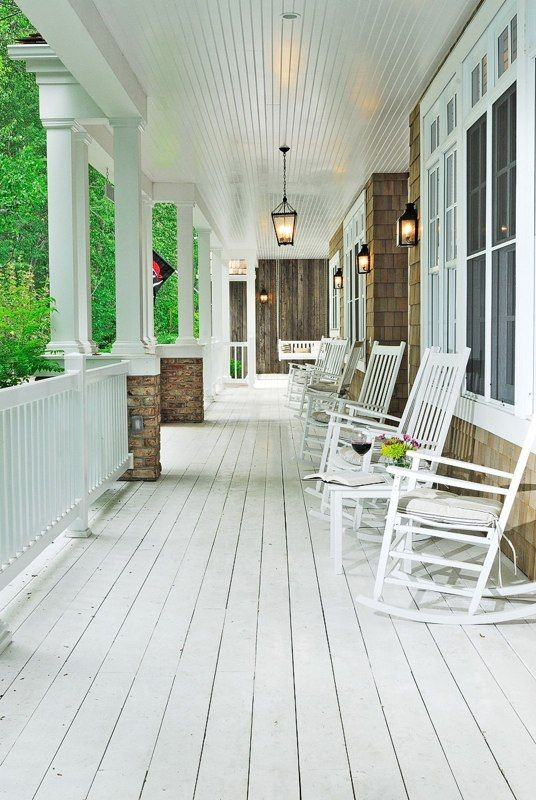 wrap around porch with rocking chairs and a swing to sit in and watch the kids