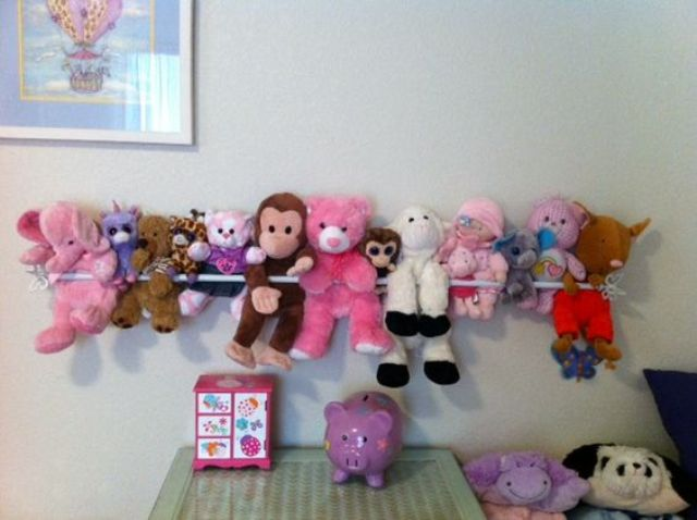 a curtain rod is perfect for displaying stuffed animals