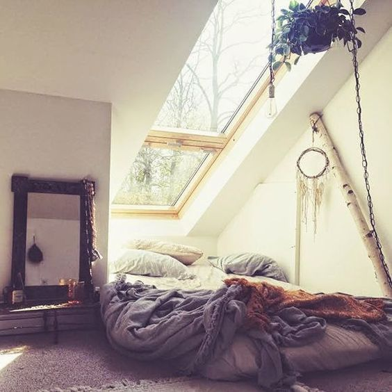 boho bedroom with a bed at the window