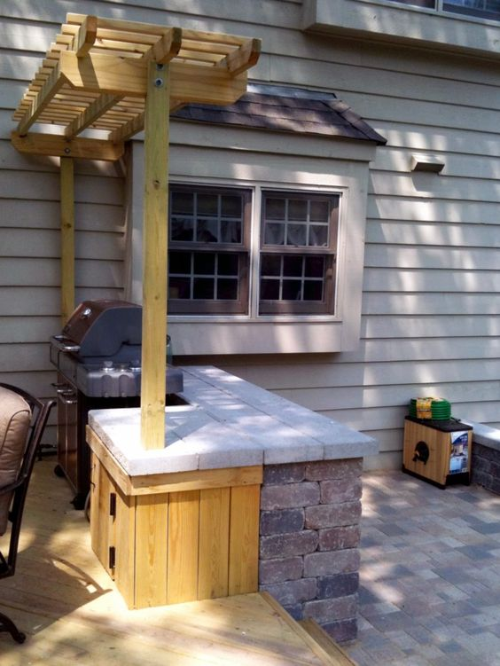 deck grill surrounded with a pergola