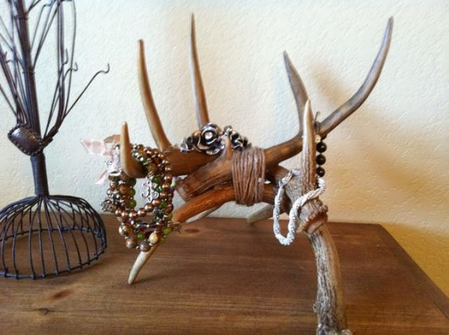 Luxury tied up antlers for a table jewelry holder
