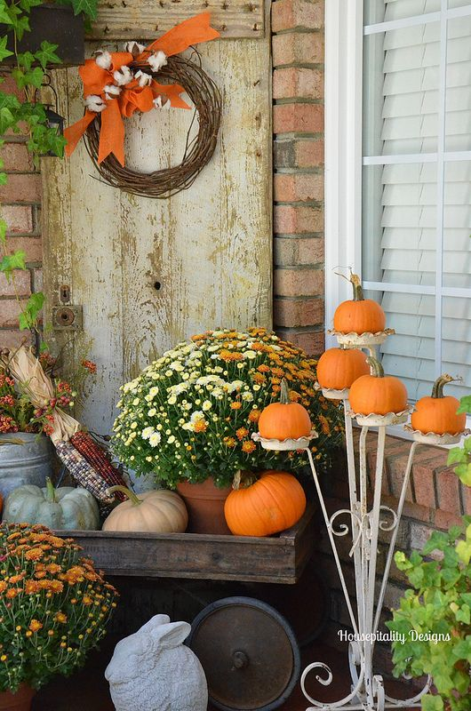 vintage plant stand for pumpkins and a wood trolley as a lardy fall-inspired display