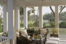 12 wrap around porch with a cozy sitting corner and wicker furniture