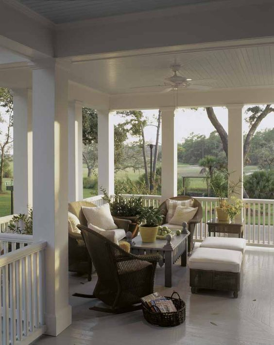 wrap around porch with a cozy sitting corner and wicker furniture