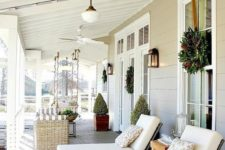 13 back porch with loungers and a swining sofa to sunbathe