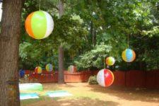 13 beach balls hung as decorations