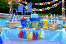 13 bold pool dessert table decorated with life savers and garlands