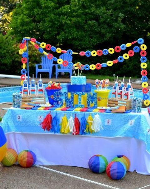 bold pool dessert table decorated with life savers and garlands