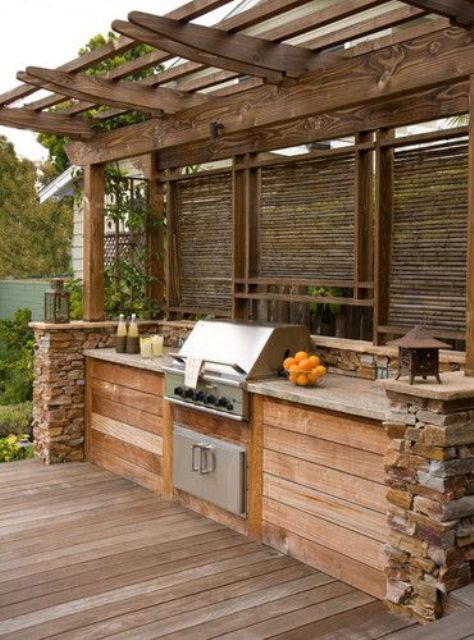 built-in grill island with a pergola over it