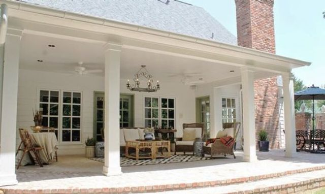 back porch with pillars with an outdoor living room