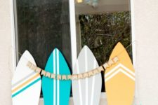 14 cardboard surf boards for decorating tables and stations