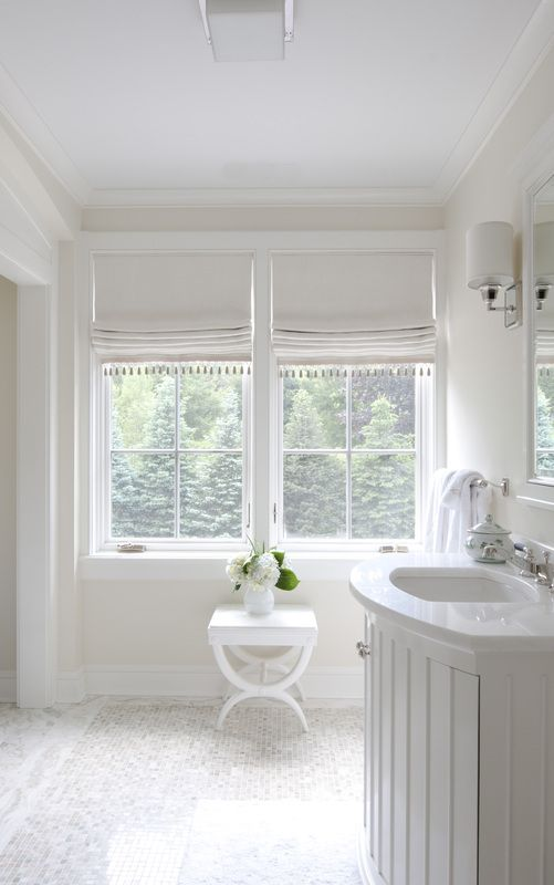 cream tassel shades add a chic touch to the decor - Bathroom Window Treatments