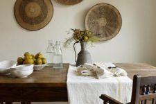 15 African baskets on the wall of a dining room
