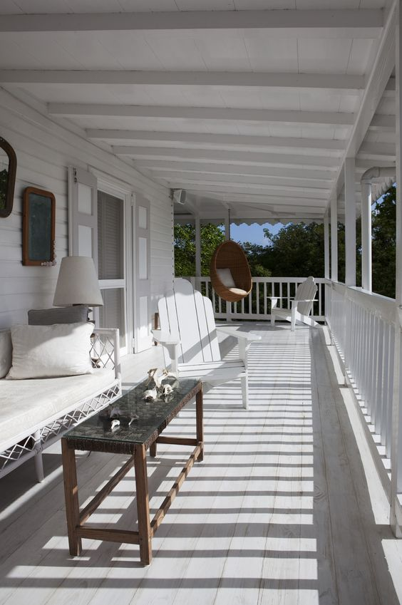 15 coastal-styled whitewashed porch with a wicker hanging chair