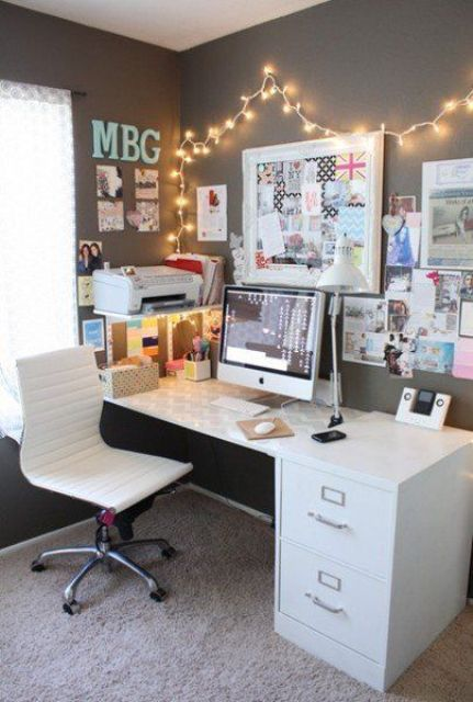 girl's teen study space with frames, pics and lights over it