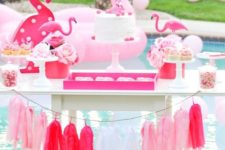 16 flamingo cart with desserts and a tassel garland