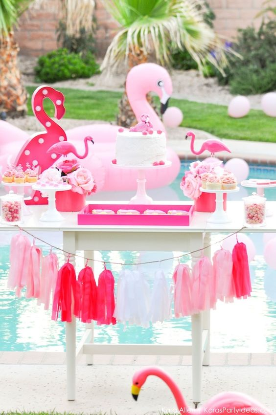 flamingo cart with desserts and a tassel garland