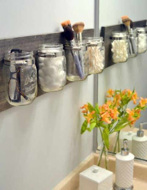 bathroom rack with jars for storing bathroom supplies