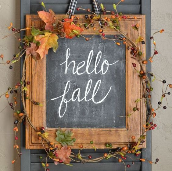chalkboard framed sign for fall decorated with faux berries