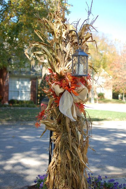 corn stalk over the shepard's hook with a lantern