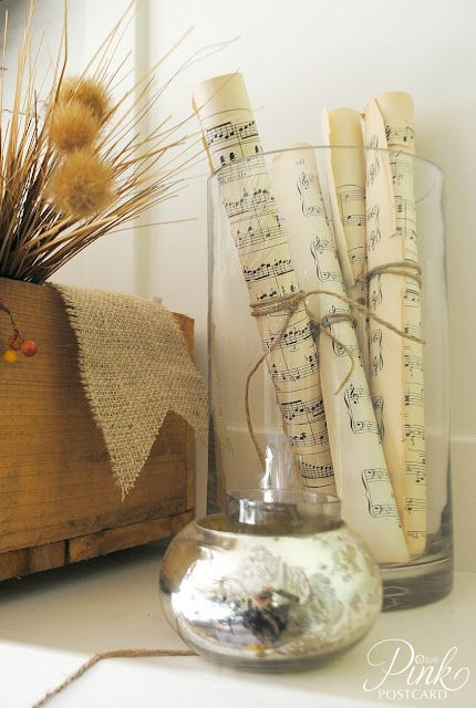 pages from old hymn books rolled and tied with twine and placed in a vase