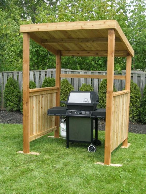 simple wooden shelter for a grill is easy to DIY