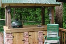 18 Weber grill cover of stone, corrugated steel and wood