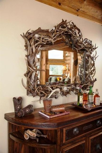 Fresh antlers for framing a large hallway mirror