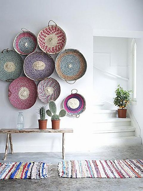 colorful handwoven baskets for decorating a wall