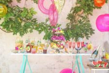18 pool toys as brightly colored party decorations for a drink table