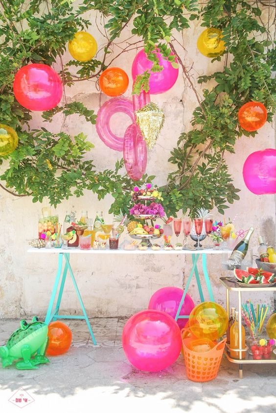 pool toys as brightly colored party decorations for a drink table