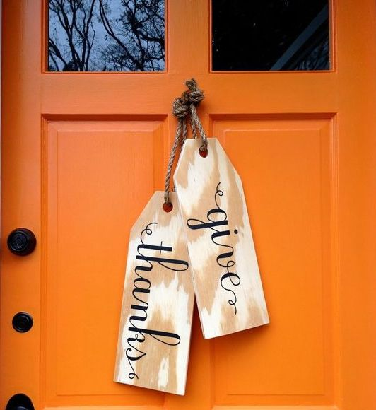 giant wood tags as door hangers for the fall
