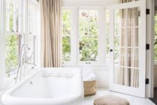 19 open and airy bathroom with neutral curtians
