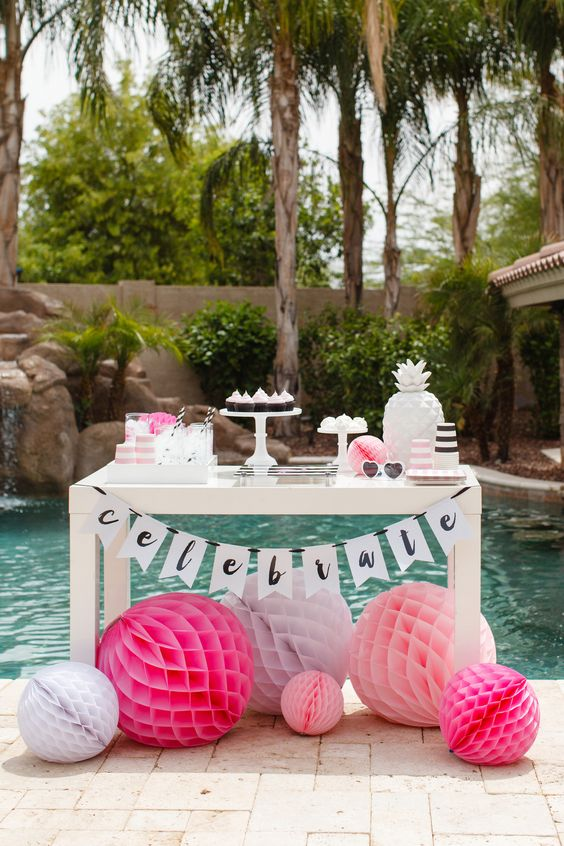 stylish dessert table with blush and fuchsia paper balls