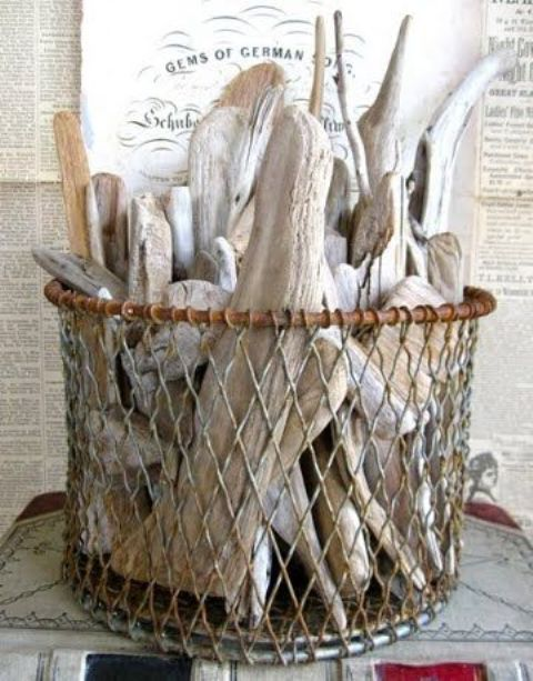 a bundle of driftwood looking great in a vintage wire basket